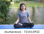 happy young girl doing yoga... | Shutterstock . vector #721013932