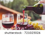 close up of red wine being... | Shutterstock . vector #721025026
