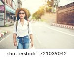 happy female tourist ... | Shutterstock . vector #721039042