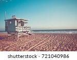 Lifeguard cabin on Santa Monica beach in California on sunset, retro toned