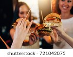 female hands holding big tasty... | Shutterstock . vector #721042075