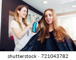 hairdresser fixing hairstyle of ... | Shutterstock . vector #721043782