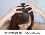 woman doing head massage | Shutterstock . vector #721060102