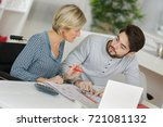 woman helping son with homework | Shutterstock . vector #721081132