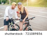 couple outdoors on a bike... | Shutterstock . vector #721089856