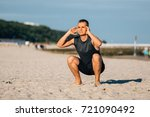 handsome young man doing sit... | Shutterstock . vector #721090492