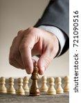 human hand moving queen chess... | Shutterstock . vector #721090516