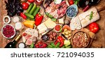 top view table full of food.... | Shutterstock . vector #721094035