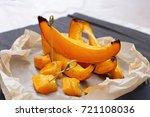 pumpkin slices baked in the... | Shutterstock . vector #721108036