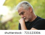 portrait of senior man thinking ... | Shutterstock . vector #721123306