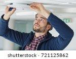 electrician installing ceiling...   Shutterstock . vector #721125862