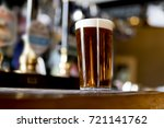 pint of real ale on the bar in... | Shutterstock . vector #721141762