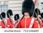 guards at buckingham palace | Shutterstock . vector #721146685