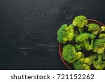 broccoli on a wooden background.... | Shutterstock . vector #721152262