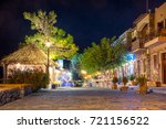night view of a street with... | Shutterstock . vector #721156522