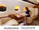 young beautiful woman in luxury ... | Shutterstock . vector #721157275