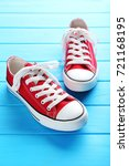 pair of red sneakers on blue... | Shutterstock . vector #721168195