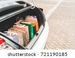 shopping bags in car trunk or...   Shutterstock . vector #721190185
