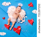 baby cupid with angel wings ... | Shutterstock . vector #721207252
