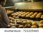 baker. a young handsome bakery... | Shutterstock . vector #721225465