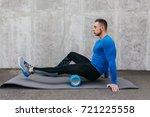 handsome healthy guy doing an... | Shutterstock . vector #721225558
