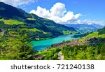 Rural Swiss Scenery from Train Ride Window View, Picturesque Lungern Village and Lake Picture as a Painting in beautiful summer, Lungern, Switzerland, Europe. Travel Swiss Nature, Tourist Attraction. - stock photo