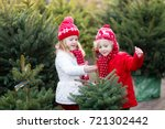 family selecting christmas tree.... | Shutterstock . vector #721302442