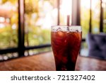 ice coffee on wooden background | Shutterstock . vector #721327402
