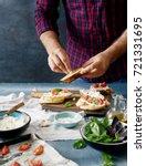 man cooking italian bruschetta...   Shutterstock . vector #721331695