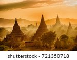sun is setting over old pagodas ... | Shutterstock . vector #721350718