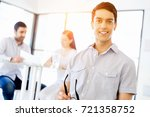 young man in casual in office | Shutterstock . vector #721358752