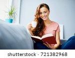 pretty joyful young woman...   Shutterstock . vector #721382968