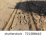 footprints in the sand | Shutterstock . vector #721388662