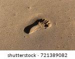 footprints in the sand | Shutterstock . vector #721389082
