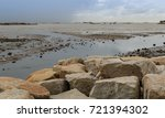 the rocks show after the sea... | Shutterstock . vector #721394302