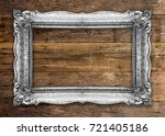 old picture frame on wooden... | Shutterstock . vector #721405186