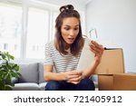 stressed young woman sitting in ... | Shutterstock . vector #721405912