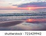 sunset on the beach. baltik sea  | Shutterstock . vector #721429942