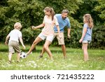mother plays football soccer... | Shutterstock . vector #721435222