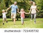 joyful family with two children ... | Shutterstock . vector #721435732