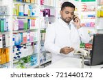 confident pharmacist using... | Shutterstock . vector #721440172