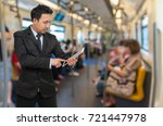 asian businessman using the... | Shutterstock . vector #721447978