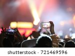 fans who take photos and record ... | Shutterstock . vector #721469596