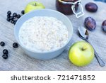 oatmeal with apples  plums and... | Shutterstock . vector #721471852