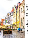 Small photo of TALLIN, ESTONIA, AUGUST 16, 2016: People are walking through a colourful street in the old town of Tallin, Estonia.