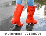 woman in red rubber boots ... | Shutterstock . vector #721488706