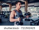 handsome muscular man is... | Shutterstock . vector #721502425