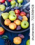 mixed fruits on a wooden... | Shutterstock . vector #721508428