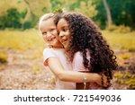 two happy girls as friends hug... | Shutterstock . vector #721549036