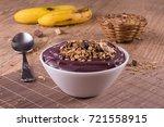 acai with banana and granola... | Shutterstock . vector #721558915